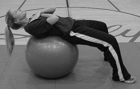 Lie supine position on ball with arms crossed over chest.