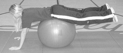 Using the abdominal muscles, crunch up, lifting chest and shoulders up with the