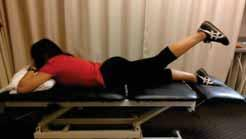 Contract glut muscles to then lift leg from the surface while keeping point of hip in contact with the table.