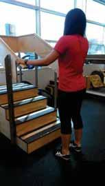 D. Standing step taps: Patient stands facing step and engages core musculature.