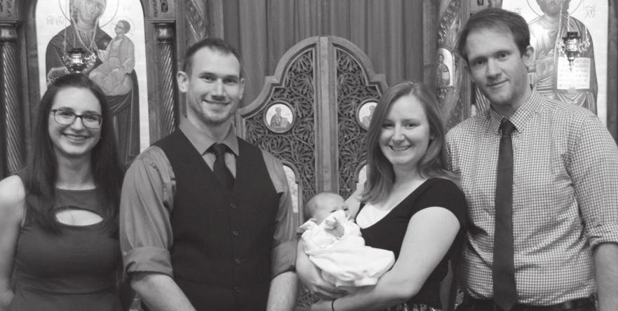From left to right: Sarah Rigby, godmother; Andrew Hayes, father; Anna Hayes, mother (holding the newly baptized David Andrew Hayes); Eric Hayes, godfather.