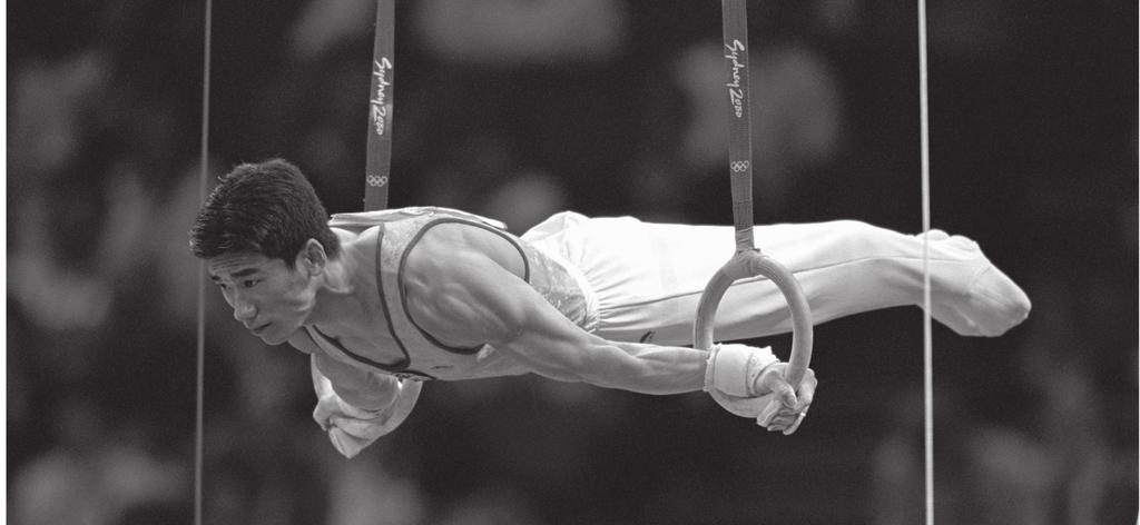 6. (a) The gymnast in Figure 3 is holding a position on the rings.