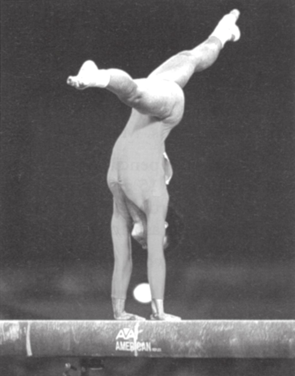 16. Figure 7 shows a gymnast on a beam A B Figure 7 (Source: Colorsport) (a) The gymnast is currently supporting her weight on her wrists. (i) What type of bones form the wrist?