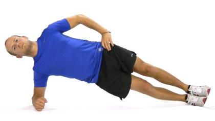 2 Raise and lower hip Starting position: Lie on your side with both legs straight, sup- port yourself on forearm.