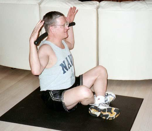 Stretch by Lateral Flexion Start in a seated position with legs crossed.