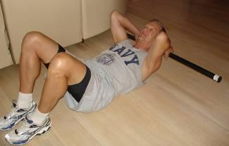 Abdominal Crunch with Neck and Head Supported Lie on the back with legs bent and feet flat on the floor. Place the Body Bar FLEX behind the neck with hands lightly grasping bar, palms facing down.