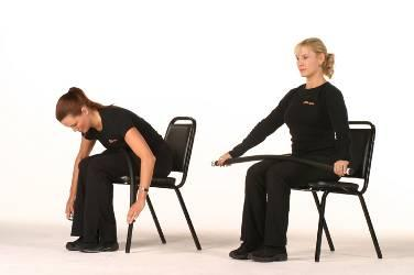 Abdominal Crunch while Seated in a Chair Sit at the edge of a sturdy chair, with feet hip width apart. Place the Body Bar FLEX on top of the thighs and hold ends, palms facing down.