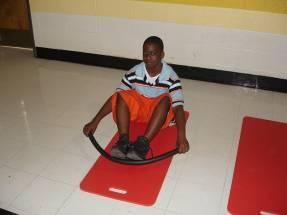 Rowing Exercise and Stretch Sit on the floor with legs bent and feet together.