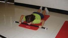 Lower Back Extension Lie on the floor in a prone position with the Body Bar FLEX perpendicular to the body length and chin positioned on surface of the bar (photo A ).