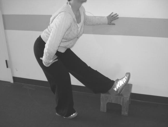 pain/discomfort Ø Repeat to stretch the opposite thigh 4) Hamstring Stretch Ø Using a wall or table for support, stand sideways to it Ø Put all of your body weight on one leg and bend that leg Ø Take