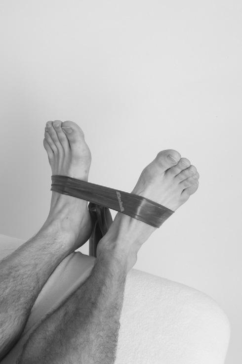 Case studies 3 Treatment and Rehabilitation Fig 3.15 Ankle eversion strengthening exercises with theraband.