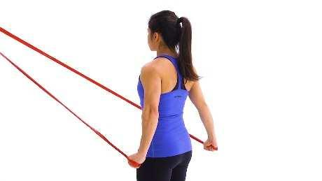 Shoulder External Rotation Reactive Isometrics Begin standing upright with your elbow bent at a 90-degree angle and a towel roll tucked under your upper arm, holding a resistance band that is