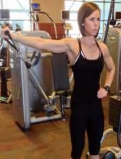 With right hand, grip the handle behind your back and begin with handle just behind right glute area.
