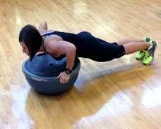 Position body behind a Bosu ball with platform side up. 2.