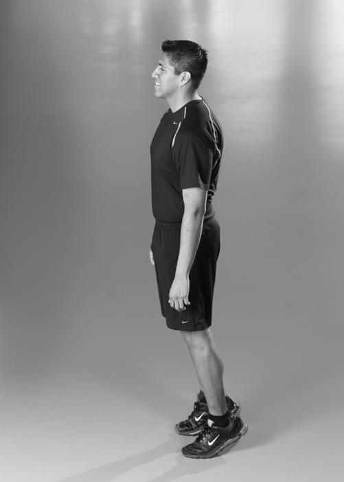 Calf Raise Stand with the feet apart, good posture, and head up.