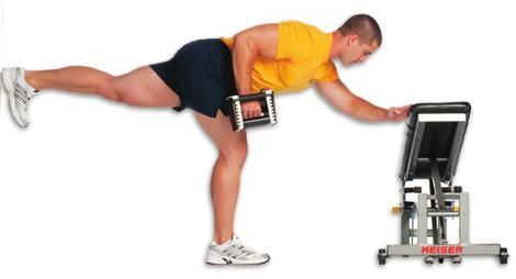 Keeping one arm straight, lower the other dumbbell until your arm just breaks parallel