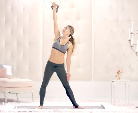 Stand tall with kettlebell in hand, lift one leg slightly and place it behind you,