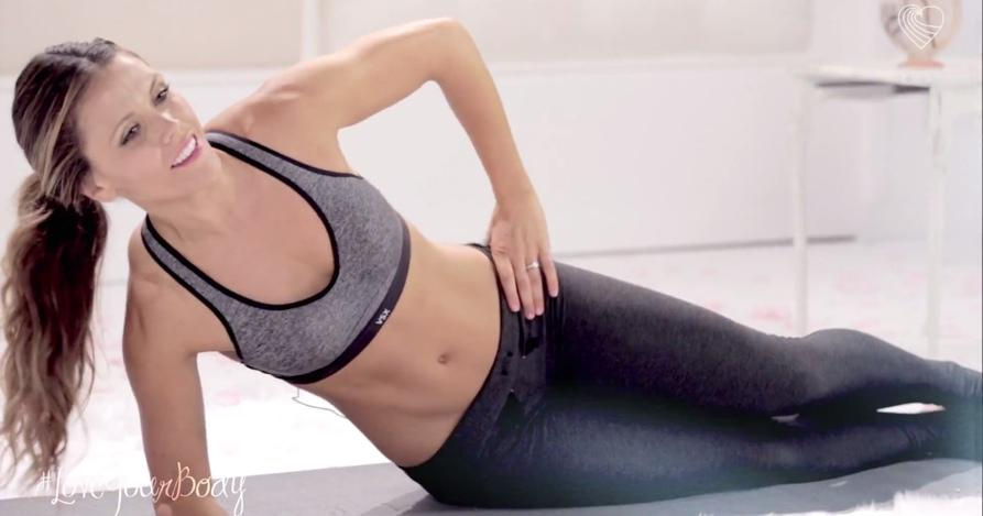 With your right arm out at your side at 45º, crunch up by squeezing your abs and sitting up