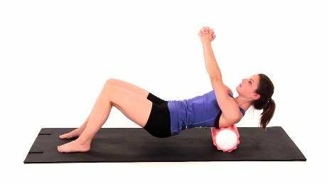 Rhomboids Mobilization on Foam Roll Begin sitting on the floor with a wrapped foam roll horizontally under your upper back.