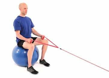 Seated Bilateral Elbow Flexion with Resistance on Swiss Ball Begin sitting on a swiss ball holding the ends of a resistance band in each hand, facing the anchor point.