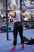 Hold on to the bar using both arms at each side and lift it off the rack by first pushing with your legs and at the same time straightening your torso. 3.
