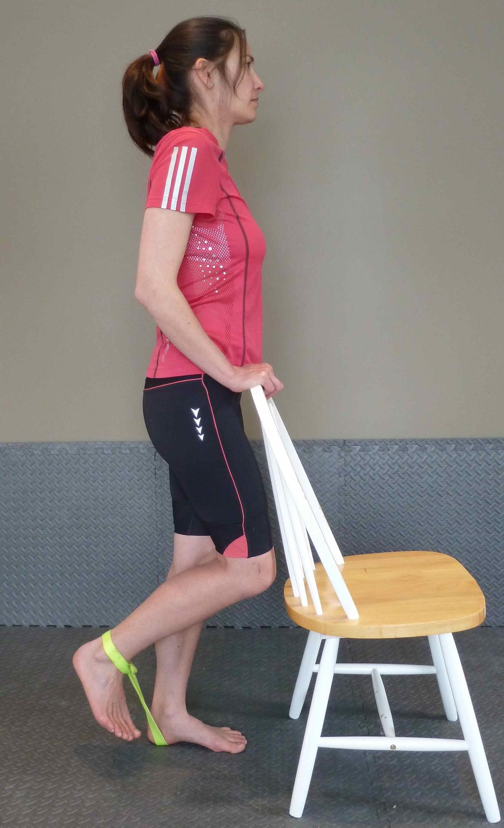 Have a resistance band secured at ground level and looped around your ankle.