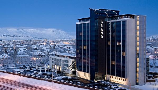 is Room reservations have been made at the Grand Hotel Reykjavik which is located 5 minutes