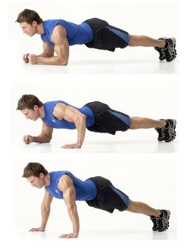 Contract the abs to curl the hips off the floor, reaching the legs up towards the ceiling. Lower and repeat.