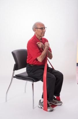 Stand with your feet hip-distance apart or sit in a chair with a straight back. Do not slouch in the chair. Place the band under the left foot. Start with moderate tension on band.