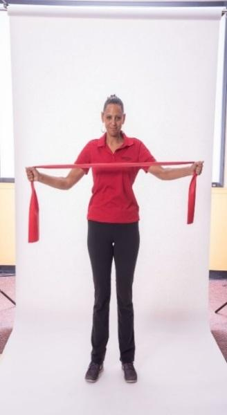 STANDING REVERSE FLY - BAND Stand with your feet hip-distance apart. Grasp one end of the band in each hand. Lift the arms to shoulder height.