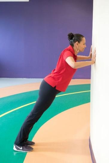 Keep a slight bend in the elbows. Squeeze the shoulder blades together. Slowly return the arms to the starting position and repeat.