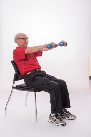 STANDING CHEST PRESS - BAND Stand with your feet hip-distance apart or sit on a chair with a straight back.