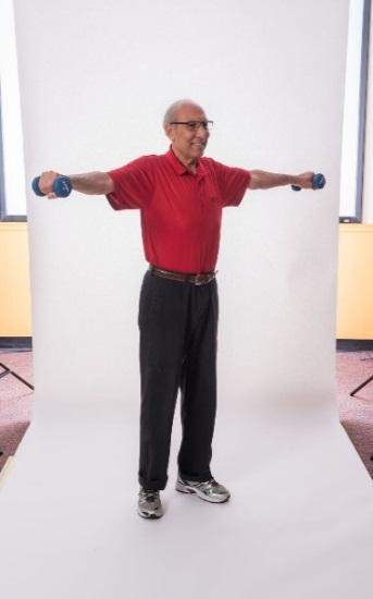 FRONT SHOULDER RAISE - BAND Stand with your feet hip-distance apart or sit in a chair with a straight back. Do not slouch in the chair. Place the band under your right foot.