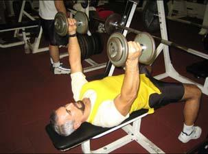 At midpoint, upper arms are parallel to floor and forearms are vertical, directly under the barbell.