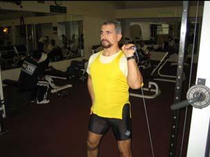 Program C1 Chest and Shoulders SHOULDERS 9. Single Arm Press (lower pulley) Muscle: Front of shoulder Resistance: ed pulley Body Connection: Thighs Adjust the pulley to the lowest position.