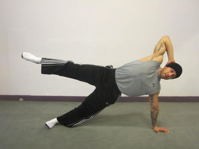 Oblique Kick Begin on your side. Place left hand down on the floor, opposite hand behind the head Extend both legs straight out onto the floor.