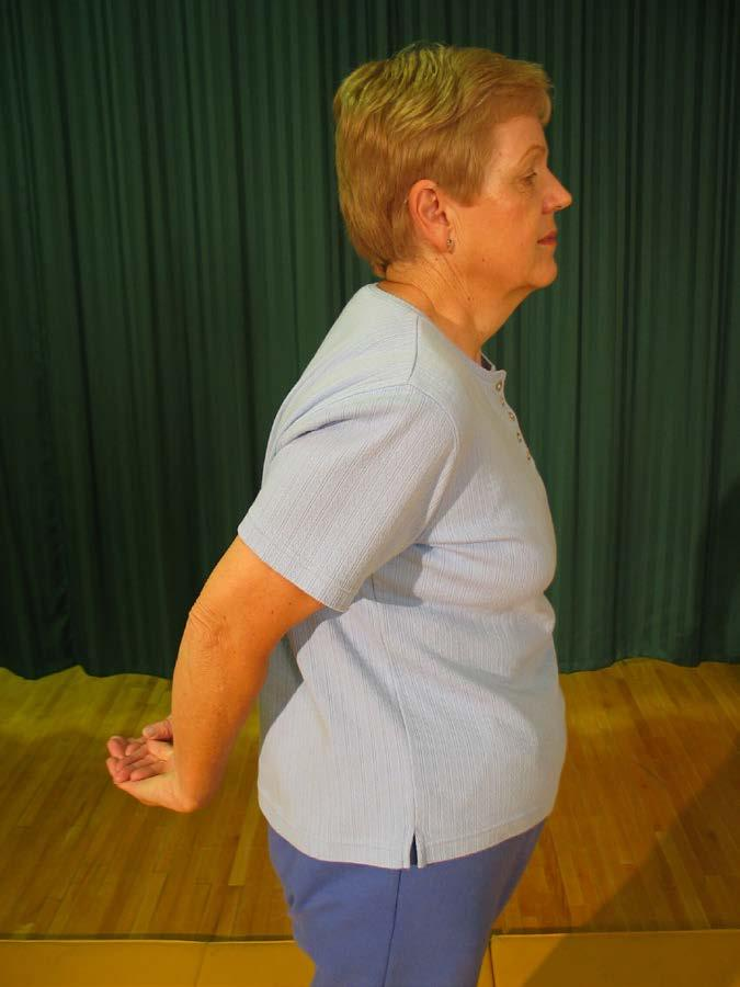 1 To stretch neck muscles: Sit straight. Turn head to left as far as it will go and hold six seconds.
