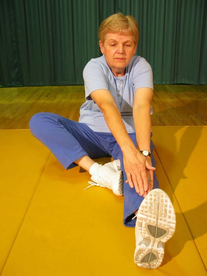 Straighten right leg and bring sole of left foot to rest next to inside upper part of straight leg.