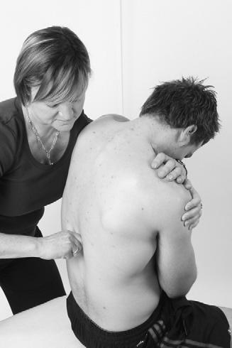 Treatment and Rehabilitation Fig 3.46 SNAG technique to increase mobility of the thoracic spine.