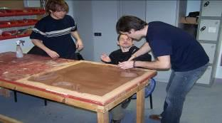 Slide 45 Figure 29 DeafBlind man working on