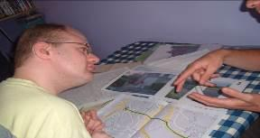 Slide 7 Figure 1 Marshall working on enlarged street maps in the bedroom.