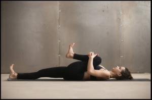 Knee to opposite shoulder 1. Lie on your back with your legs extended and your feet flexed upward. 2. Bend your right leg and clasp your hands around the knee. 3.