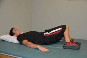 Exercise 3: Hip Rolling Starting Position: Lie on your back on a table or firm surface. Both knees bent, feet flat on the table. Action: Cross your arms over your chest.
