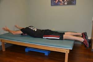 Lower the head and shoulders. Do not tense your shoulder muscles. Exercise 13: Arm Lifts Starting Position: Lie on your stomach on a mat.