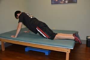 Exercise 15: Knee Push Up Starting Position: Lie on your stomach on a mat. Place your hands, palms down, on the mat at the level of your shoulders.